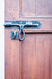 Closeup vintage wooden door locked Stock Photo