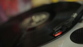 Closeup of vinyl record spinning on retro player, vintage music collection. Stock footage stock video footage