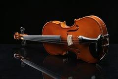 Violin on a black background. Closeup violin on a black background Stock Photos