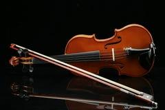 Violin on a black background. Closeup violin on a black background Stock Image