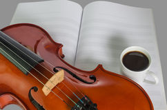 Closeup of violin, blank note sheet and pencil Royalty Free Stock Images