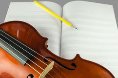 Closeup of violin, blank note sheet and pencil Stock Photo