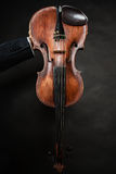 Closeup of violin instrument. Classical music art. Art. Closeup of old wooden violin stringed instrument on dark gray. Classical music Royalty Free Stock Photos