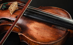 Closeup of violin instrument. Classical music art. Art. Closeup of old wooden violin stringed instrument on dark gray. Classical music Stock Images