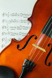 Closeup of violin on note sheet Stock Image