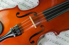 Closeup of violin on note sheet Stock Images