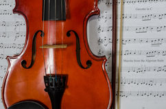 Closeup of violin on note sheet Royalty Free Stock Photo