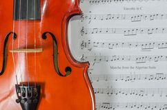 Closeup of violin on note sheet Royalty Free Stock Photography