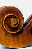 Closeup of a violin scroll. Macro closeup of a wooden violin scroll Stock Photography