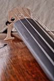 Closeup of a violoncello isolated on beige background Stock Photography