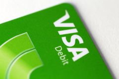 Visa Debit Card in a Closeup Photo. Closeup of a Visa debit card. Green colored credit card offered by Finnish cooperative S-Pankki. Photographed in Kuopio royalty free stock image