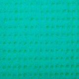Closeup vivid turquoise sponge background texture pattern Stock Photos