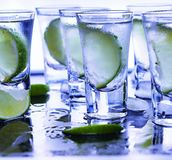 Closeup vodka in a glass with ice, lime vodka, Gin, tonic, tequila Stock Photography