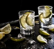 Closeup vodka in a glass with ice, lime vodka, Gin, tonic, tequila Stock Photo