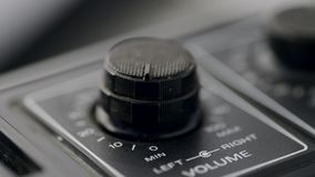 Closeup of volume rotary. Closeup of volume and tone rotary of vintage cassette deck, sliding camera movement stock video footage
