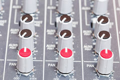Closeup on volumes of sound mixing console in audio recording st Royalty Free Stock Images