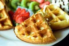 Closeup of waffle with fresh fruits and whipped cream Stock Photo
