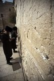 Wailing Wall Prayers. A closeup of the Wailing Wall in the old city of Jerusalem. In the cracks between the bricks there are numerous notes with pleads and royalty free stock photos