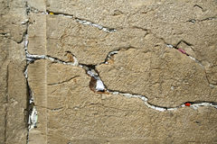 Notes in the Wailing Wall. A closeup of the Wailing Wall in the old city of Jerusalem. In the cracks between the bricks there are numerous notes with pleads and royalty free stock photography