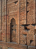 Closeup of a Wall, Qutub Minar, India. The Qutub complex included a mosque whose structure included wall panels with calligraphy and decorative carving. An Royalty Free Stock Photos