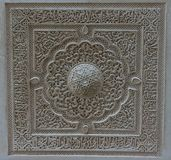 Closeup of a wall of white plaster with arabic design in Alhambr. A, Granada, Spain, Europe on a bright summer day Stock Photo