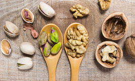Closeup of a walnut and pistachios. Royalty Free Stock Photography