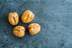 Closeup on walnut on stone substrate Royalty Free Stock Photos