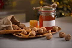 Closeup on walnuts and jar of honey on table Stock Image