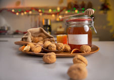 Closeup on walnuts and jar of honey on table Royalty Free Stock Photos