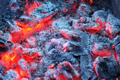 Closeup of warm glowing embers in fireplace Royalty Free Stock Images