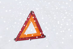 Closeup of warning triangle on snow Stock Photo