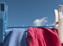 Closeup of Washing on Line - with a Blue Sky. Washing hanging on a line with a lovely blue sky stock photos