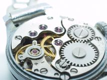 Closeup of watch mechanism. A closeup view of the internal gears and mechanism of a wristwatch Stock Photo