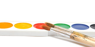 Closeup water color paints and brushes Stock Image
