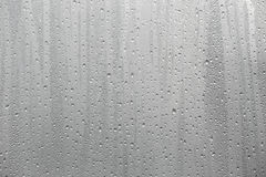 Closeup water condensation on window glass background Stock Images