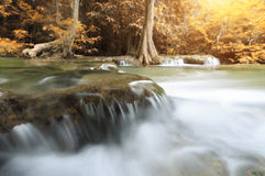 Closeup water motion of waterfall in autumn season. Close up water motion of waterfall in autumn season Stock Photo