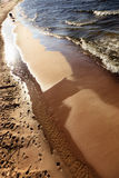 Closeup of water waves at sandy beach. Sea or ocean. Royalty Free Stock Photography