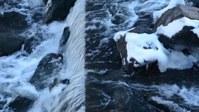 Closeup of a waterfall in the city. Closeup high angle shot of a waterfall in the city during winter stock video footage