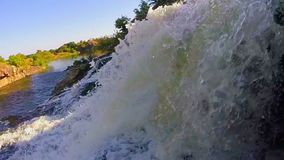 Closeup, waterfall falling into river, beautiful nature, sunset. Stock footage stock video