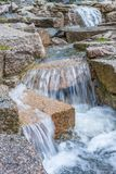 Closeup of Waterfall. A Closeup of a Small Waterfall in Sweden with Large Rocks Royalty Free Stock Image