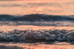 Closeup waves in the sunset. Closeup waves reflecting sunset light Royalty Free Stock Photography