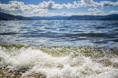 Closeup of Waves Rolling into Beach Shoreline Royalty Free Stock Photo