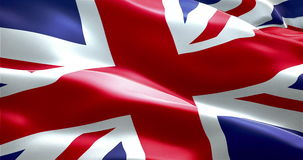 Closeup of waving flag of union jack, uk great britain england symbol stock footage
