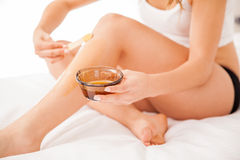 Closeup of wax hair removal Stock Photography