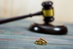 Closeup of wedding rings on wooden mallet at table. In courtroom stock images