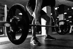 Closeup of weightlift workout at the gym with barbell. Royalty Free Stock Image