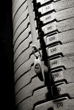 Closeup of weights. Dramatic closeup of weight machine with black background Royalty Free Stock Image