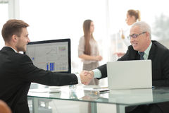 Closeup - Welcome handshake before the start of negotiations at Royalty Free Stock Photo