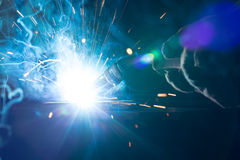 Closeup of welding metal with arc and torch. Closeup of welding metal with arc, sparks and torch Stock Images