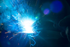 Closeup of welding metal with arc and torch Stock Image